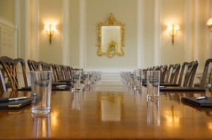 Table set in ornate meeting room