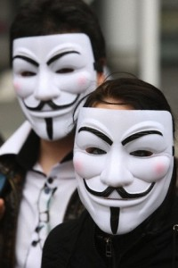 Protesters wearing Guy Fawkes masks , trademark of the Anonymous movement and based on a character in the film V for Vendetta.