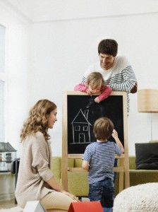 Parents with two kids (2-3,4-5) imagining their future home together