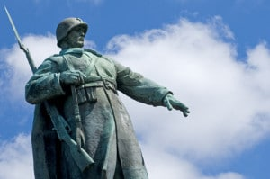 The imposing statue of a soldier atop the Soviet War Memorial in the Tiergarten, Berlin, Germany. Image by © Dreamstime