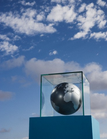 Globe in glass box on pedestal