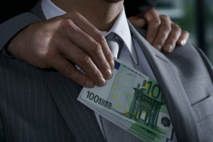 Businessman Being Bribed with Euros
