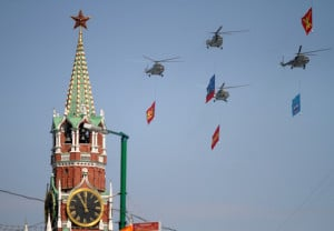 Russian army helicopters with flags fly over the Kremlin during Victory Parade in Moscow. Image by © Dreamstime