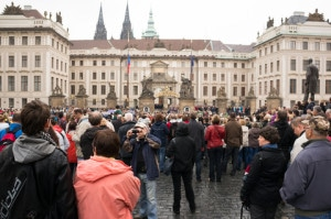Many people standing in front of the entrance to the old government house in Prague, Czech Republic. Image by © Dreamstime