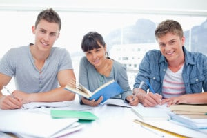 Students doing homework together Image by © Dreamstime